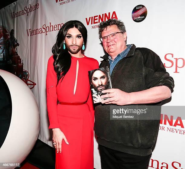 Conchita Wurst and Guenter R Rodewald pose with the book 'Conchita Wurst Maine Geschichte' 'Conchita Wurst My History' at the ViennaSphere at the...