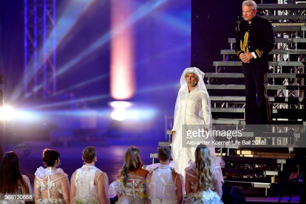 Conchita Wurst and Herbert Foettinger are seen on stage during the Life Ball 2018 show at City Hall on June 2 2018 in Vienna Austria The Life Ball an...