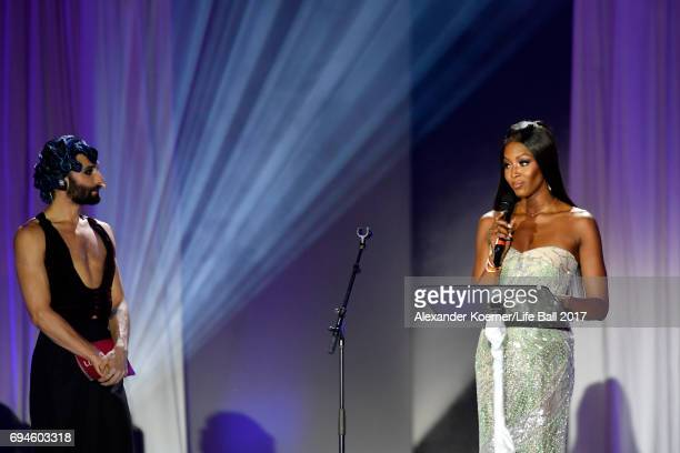 Conchita Wurst and Naomi Campbell speak on stage during the Life Ball 2017 show at City Hall on June 10 2017 in Vienna Austria