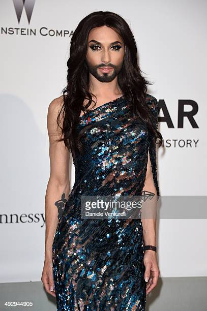 Conchita Wurst attends amfAR's 21st Cinema Against AIDS Gala Presented By WORLDVIEW, BOLD FILMS, And BVLGARI at Hotel du Cap-Eden-Roc on May 22, 2014...