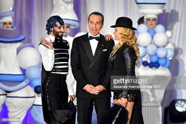 Conchita Wurst Christian Kern and Verena Scheitz speak on stage during the Life Ball 2017 show at City Hall on June 10 2017 in Vienna Austria