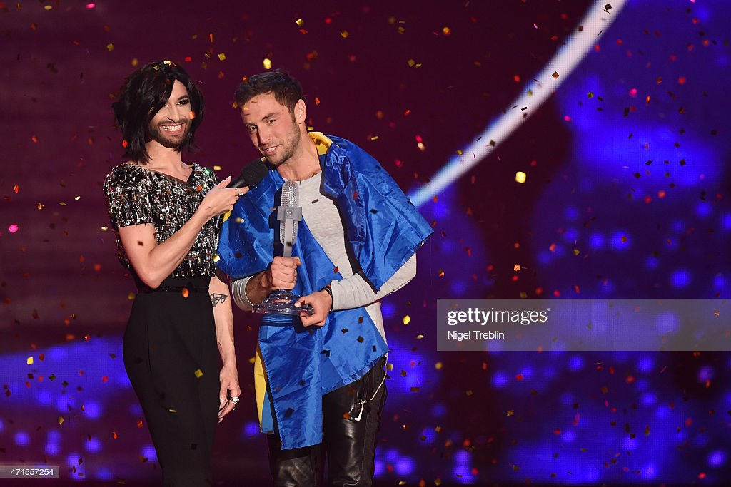 Conchita Wurst hands over the trophy to Mans Zelmerloew of Sweden after winning the final of the Eurovision Song Contest 2015 on May 23, 2015 in Vienna, Austria. The final of the Eurovision Song Contest 2015 will take place on May 23, 2015.