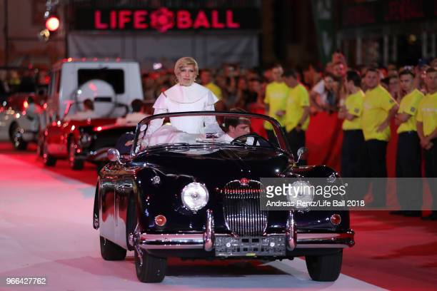 Conchita Wurst is seen riding in the back of a oldtimer during the Life Ball 2018 show at City Hall on June 2 2018 in Vienna Austria The Life Ball an...