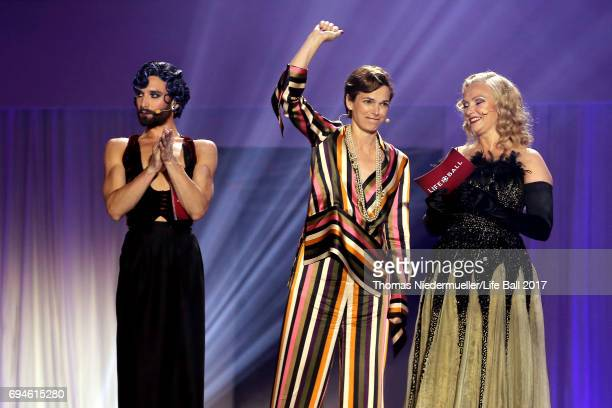 Conchita Wurst Pamela RendiWagner and Verena Scheitz speak during the Life Ball 2017 show at City Hall on June 10 2017 in Vienna Austria