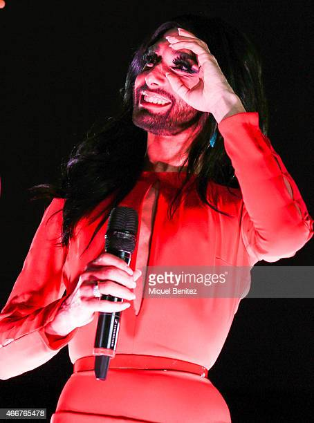 Conchita Wurst performs on stage at the ViennaSphere at the Moll de la Fusta on March 18 2015 in Barcelona Spain