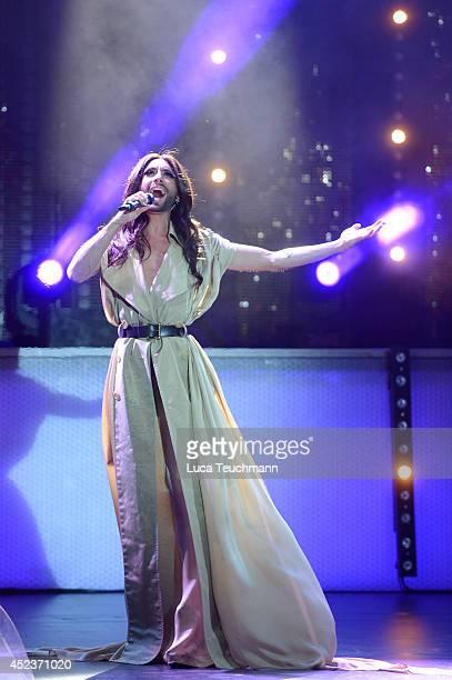 Conchita Wurst performs on stage during the 'Starnacht am Woerthersee' at Woertherseebuehne Klagenfurt on July 18 2014 in Klagenfurt Austria