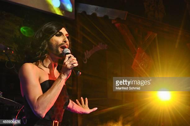 Conchita Wurst performs on stage during the Trachtenpaerchenball 2014 at City Hall on September 19 2014 in Vienna Austria