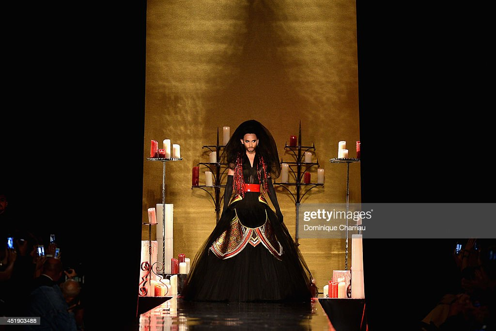 Conchita Wurst walks the runway during the Jean Paul Gaultier show as part of Paris Fashion Week - Haute Couture Fall/Winter 2014-2015 at 325 Rue Saint Martin on July 9, 2014 in Paris, France.