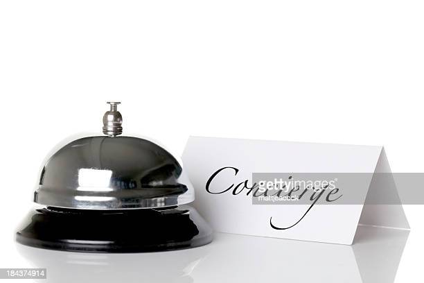 Concierge bell and nameplate against a white background