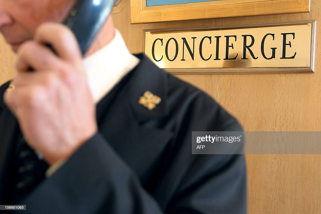 A concierge of a luxury hotel takes a reservation on January 4, 2013 in Cannes, southeastern France.