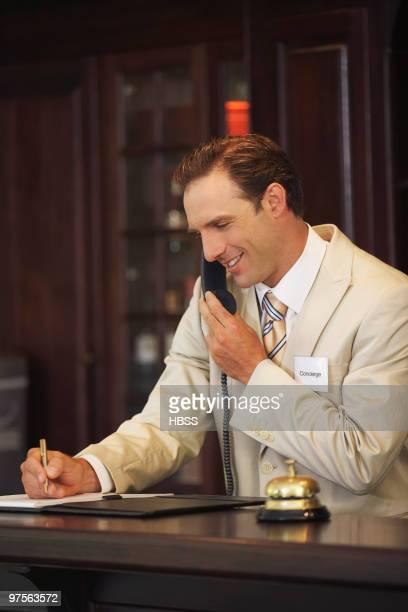 Concierge on telephone