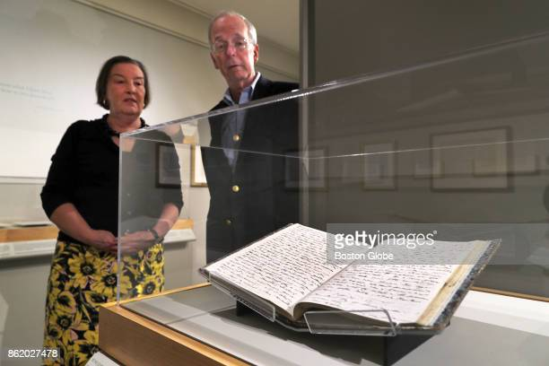 Concord Museum curator David Wood and executive director Margaret Burke stand with Henry David Thoreau's journal on display at the 'This Ever New...