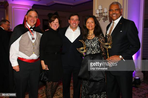 Concordance Academy of Leadership President and CEO Danny Ludeman and his wife Susan Ludeman pose for a photograph with St Louis County Executive...