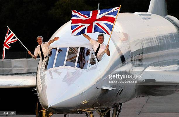 Concorde captain Mike Bannister with the Union Jack flag and senior first officer Jonathan Napier wave as they complete the last supersonic Concorde...