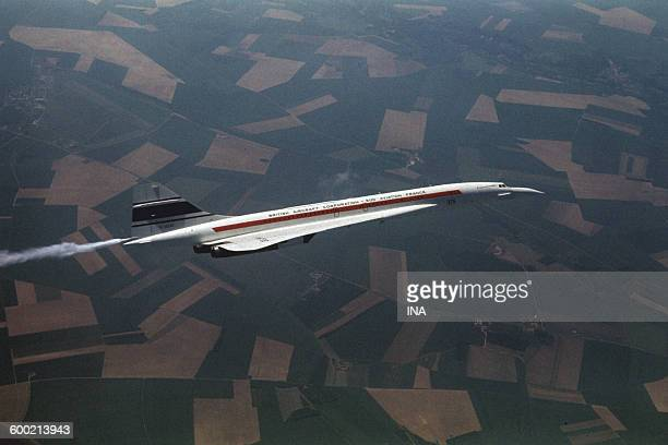 Concorde during flight above fields