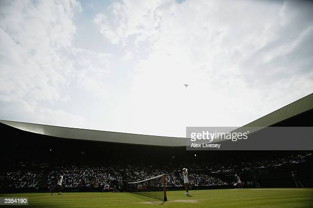 Concorde flies over Centre Court during the final day of the Wimbledon Lawn Tennis Championships held on July 6 2003 at the All England Lawn Tennis...