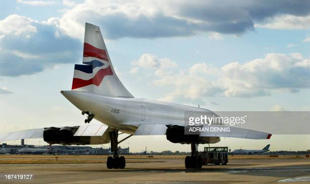Concorde is towed out from the engineering hangar at London's Heathrow airport for one of the last scheduled flights to New York 23 October 2003...