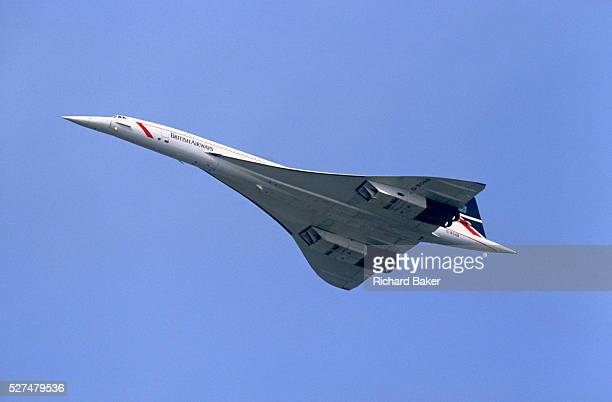 A Concorde supersonic airliner registration GBOAB flies overhead during its service for British Airways enroute for a foreign destination The...
