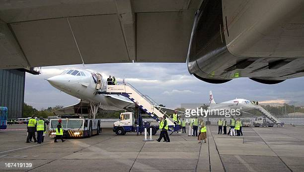 Concordes are on the ground at Heathrow 24 October 2003 after three had flown in to make the closure of Concordes life ROTA/ Martyn HAYHOW / AFP /...