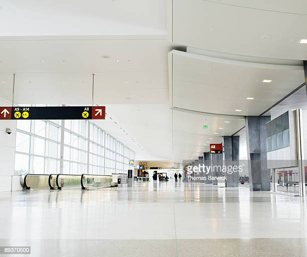 concourse at airport terminal - arrival photos stock photos and pictures