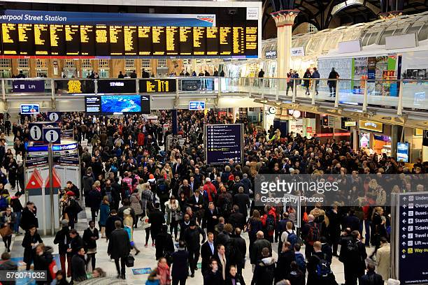 Concourse crowded with passengers at Liverpool Street station London England UK