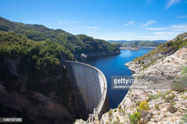 concret dam and river in tasmania island. - dam stock pictures, royalty-free photos & images