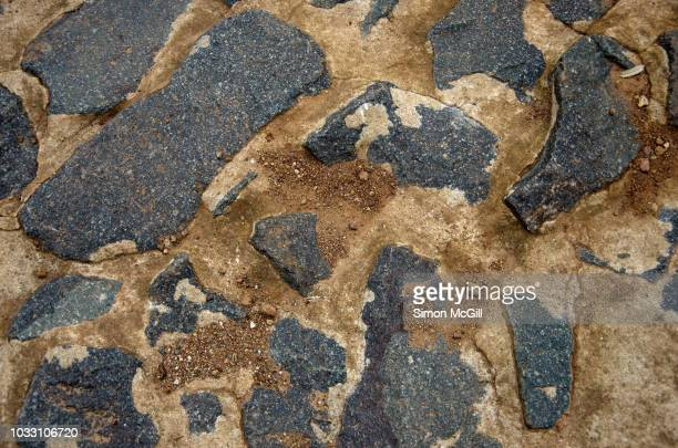 concrete and blue stone footpath - ugly wallpaper stock photos and pictures