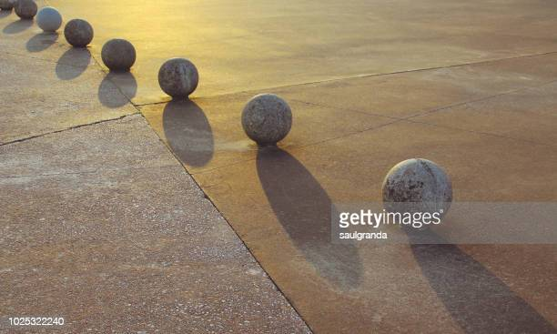 concrete balls in a row - bollard stock photos and pictures