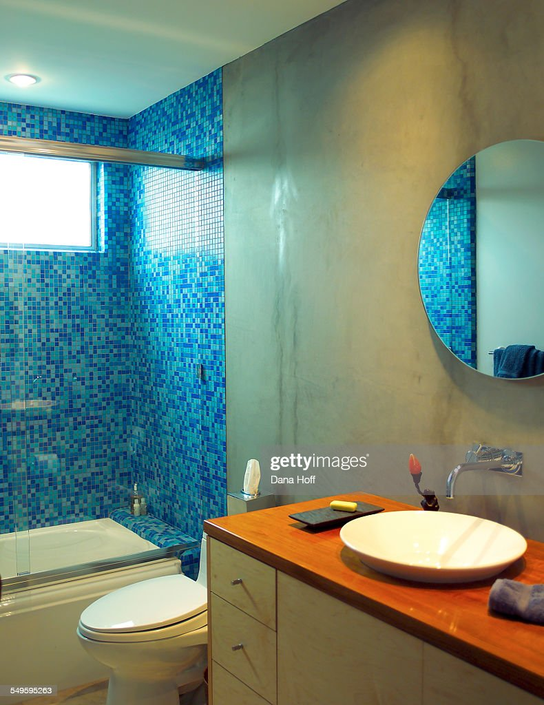 Concrete Bathroom With Blue Tiles In The Shower Stock Photo | Getty ...