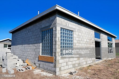 Concrete block construction before stucco series stock for Cinder block house construction