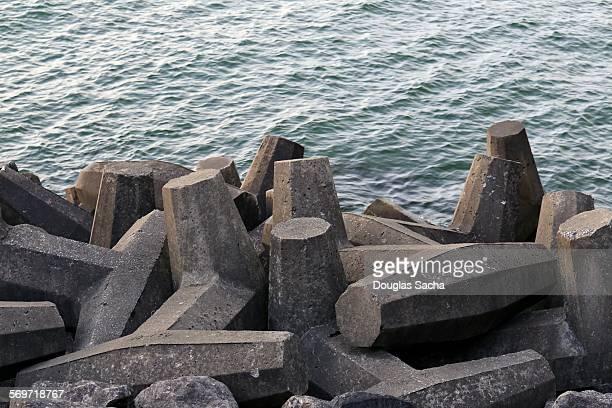 Concrete blocks are piled near the shore line