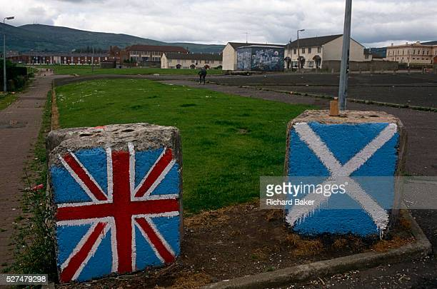 Concrete blocks painted in the colours of the Union Jack and the Scottish Saltire on a Protestant loyalist estate off the Shankill Road in Belfast...