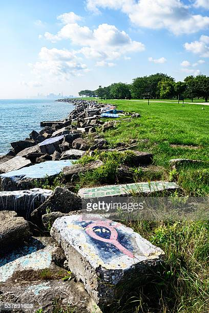concrete blocks with graffiti, lake michigan, near chicago - evanston illinois stock photos and pictures