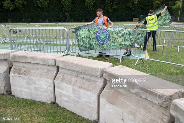 Concrete bollards and security gates are seen in the public queueing zone outside the All England Tennis Club at Wimbledon on June 30 2017 in London...