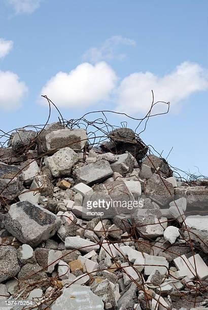 concrete construction scrap against blue sky - rubble stock photos and pictures
