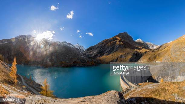 concrete dam wall of grossglockner - margaritze  stausee - reservoir stock pictures, royalty-free photos & images