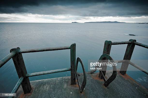 concrete diving platform - portmarnock stock photos and pictures