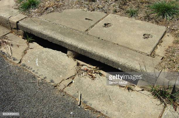 Concrete gutter and drain on a suburban road