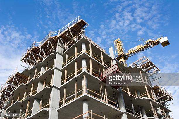 concrete highrise construction site - construction industry stock pictures, royalty-free photos & images