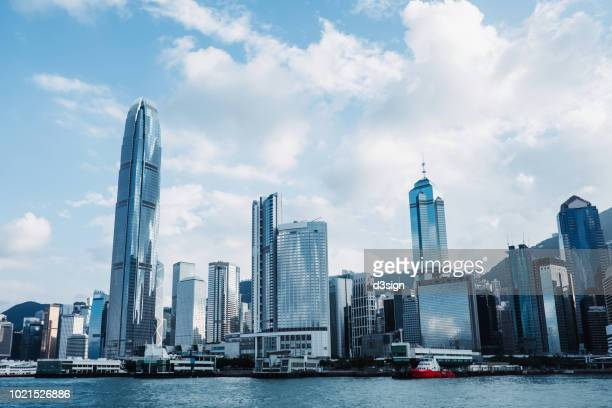concrete jungle of hong kong cityscape and modern skyscrapers in central business district - central stock pictures, royalty-free photos & images