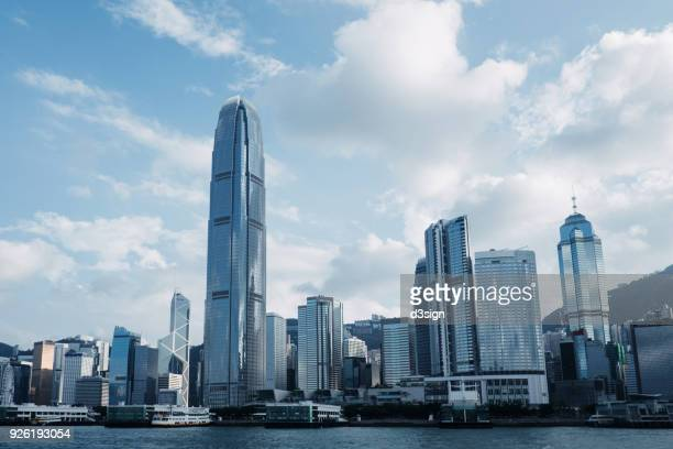 concrete jungle of hong kong cityscape and modern skyscrapers in central business district - ship front view stock-fotos und bilder