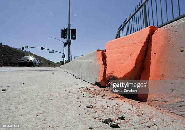Concrete near the expansion joint is broken up and spray–painted orange by officials on the six–lane White's Canyon bridge in Santa Clarita after a...