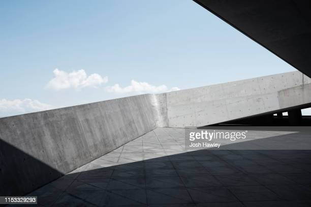 concrete  parking  lot - architecture stock pictures, royalty-free photos & images