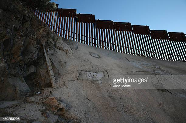 A concrete patch covers the spot where smugglers had tunneled under the USMexico border fence on December 9 2014 in Nogales Arizona With increased...