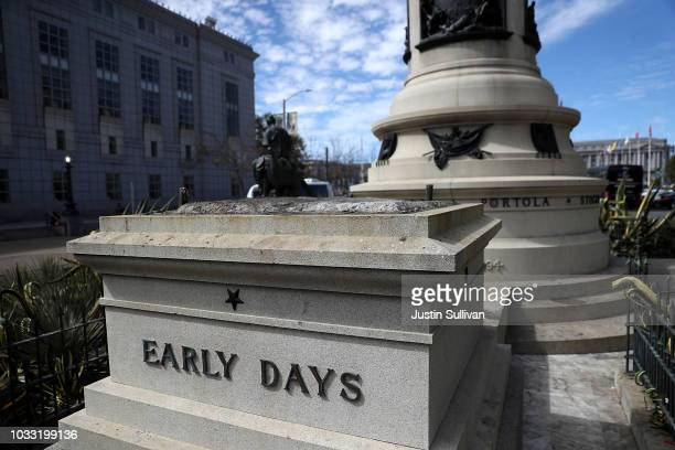 A concrete pedestal reamains where a statue known as 'Early Days' that depicted a Native American at the feet of a Catholic missionary and Spanish...