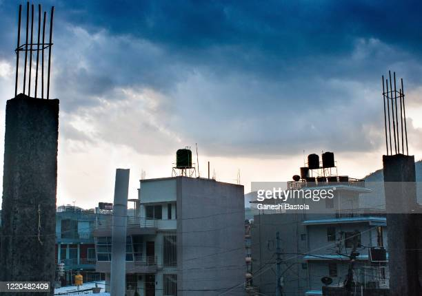 concrete pillars framing the cityscape with clouds. - pokhara stock pictures, royalty-free photos & images