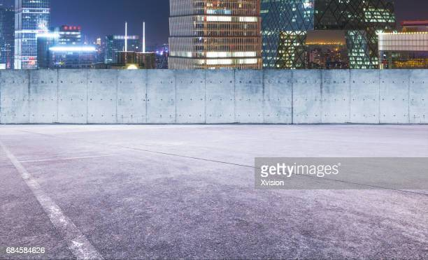 concrete platform with moder skyscraper in the background - construction platform stock photos and pictures