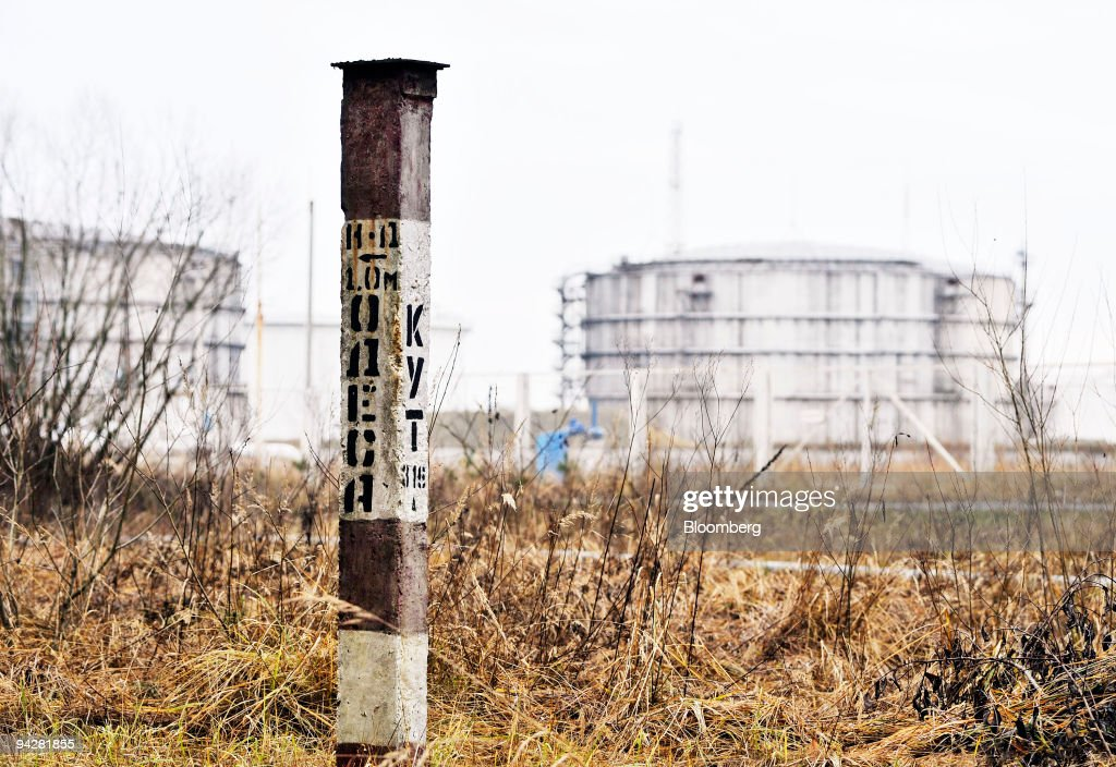 A concrete post indicates the location of the Odessa-Brody pipeline as it approches the UkrTransNafta operated terminal near Brody, Ukraine, on Saturday, Dec. 5, 2009. Ukraine plans to create a stockpile of oil and oil-based products at an estimated cost of 23 billion hryvnias ($2.87 billion), the Fuel and Energy Ministry said. Photographer: John Guillemin/Bloomberg via Getty Images