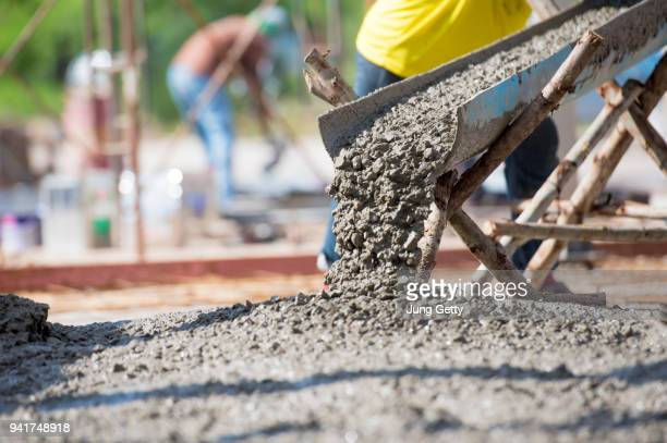 concrete pouring at construction site - cement stock pictures, royalty-free photos & images