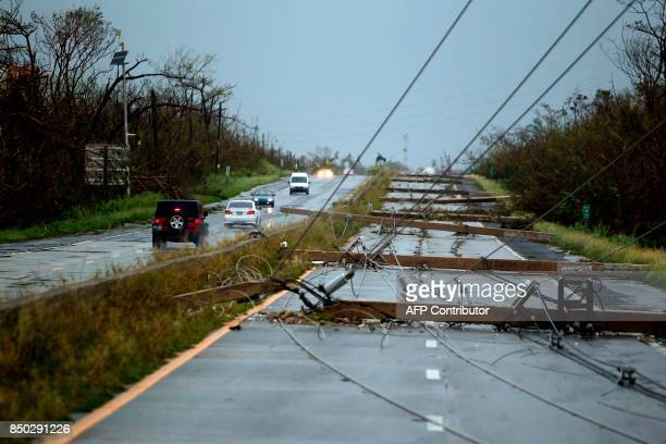 Concrete power line poles lies on a highway after the area was hit by Hurricane Maria in Luquillo Puerto Rico on September 20 2017 Maria made...